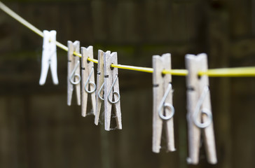 set of wooden pegs on washing line
