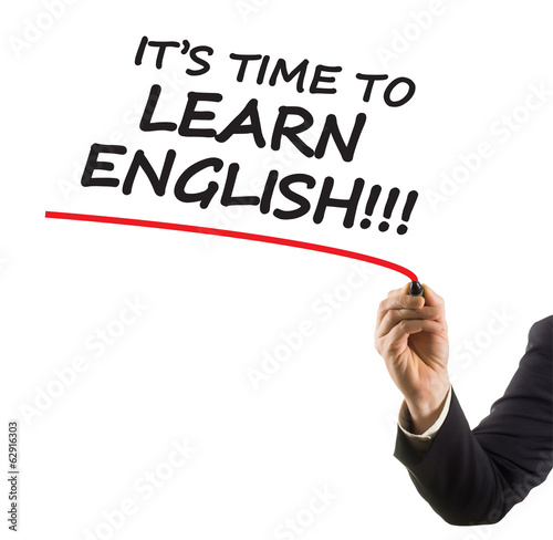 hand with marker writing text it is time to learn english