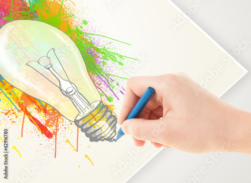 Hand drawing on paper a colorful splatter lightbulb