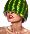 sexy model with water-melon on head with white teeth