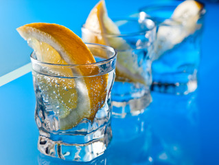 gin with lemon on a glass table