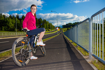 Healthy lifestyle - teenage girl biking