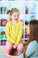 Mother daughter talk portrait.