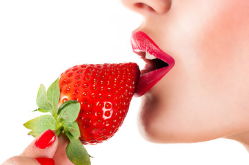 sexy woman eating strawberry, sensual red lips