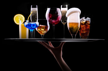different alcohol drinks set on a tray