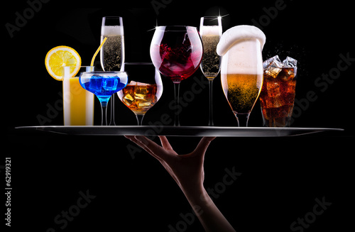 different alcohol drinks set on a tray - 62919321