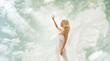 woman beauty in fashion fluttering white dress over sky