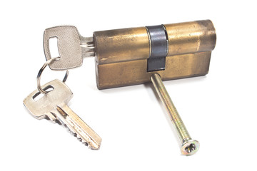 Old used brass cartridge cylinder with keys isolated on white