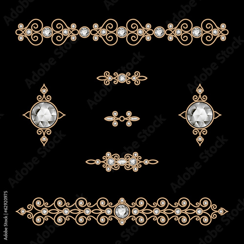 Set of vintage gold jewelry dividers on black