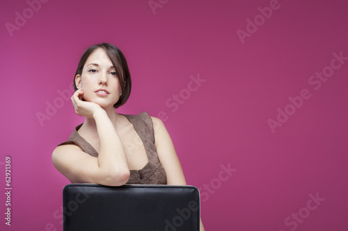Beautifull young woman on pink background