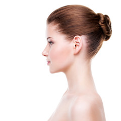 Profile portrait of young beautiful woman.