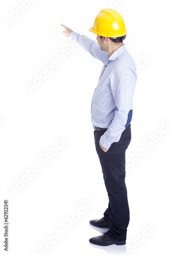 Engineer pointing at something, isolated on white