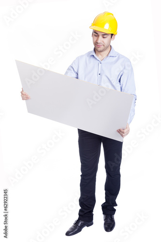 Handsome engineer holding  blueprints, isolated on white