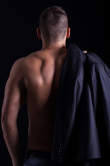 creative muscled male model showing his back