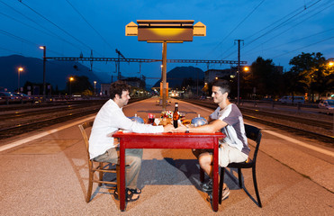 Portrait of Couple of men, dinner in station