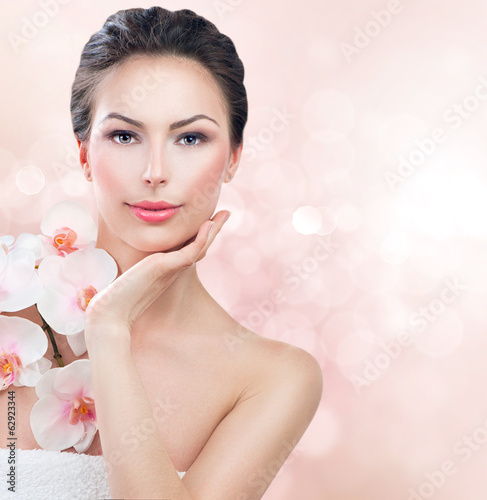 Spa woman with fresh skin. Beauty girl touching her face