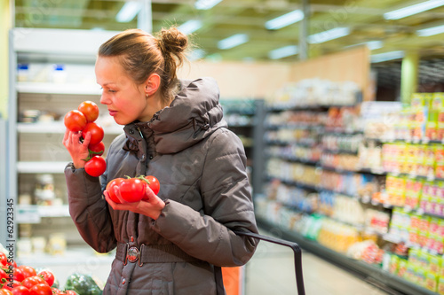 Beautiful, young woman shopping for fruits and vegetables