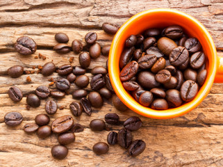 Coffee and cup on grunge wooden background Fresh coffee beans on