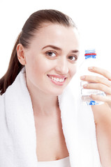 Happy smiling woman with bottle of water covering white backgrou