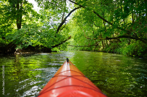 Kayak paddling on river