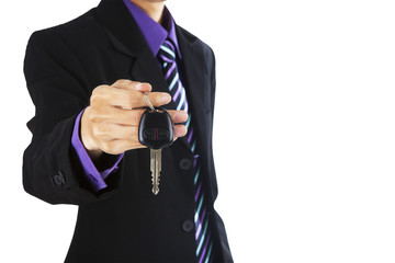 A businessman giving a car key