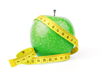 Green apple with yellow measuring tape