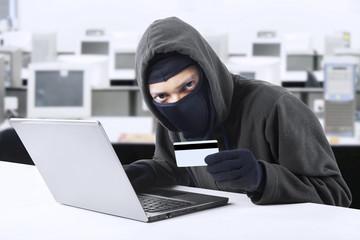 Hacker stealing credit card numbers