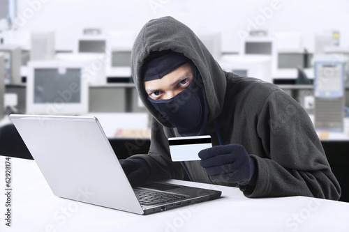 Hacker stealing credit card numbers