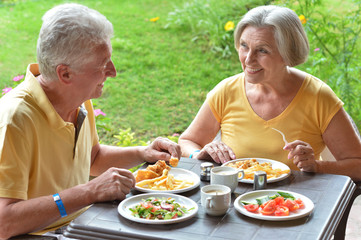 Elder couple eating breakfast
