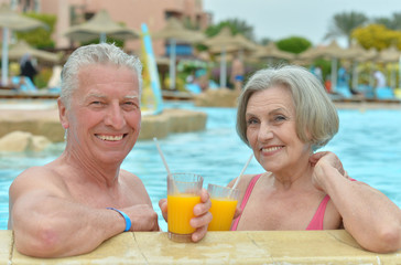 Senior couple in a pool