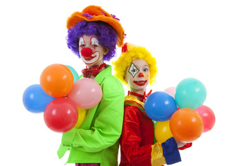 children dressed as colorful funny clowns with balloons