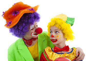children dressed as colorful funny clowns