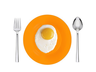 Scrambled eggs with on orange plate with spoon and fork