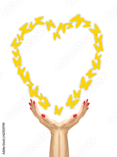 Paper yellow butterflies fly from woman hands over white backgro
