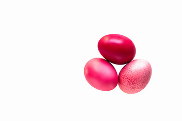 Redd and pink easter eggs isolated on white