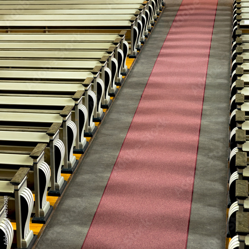 church pews and aisle in sunshine