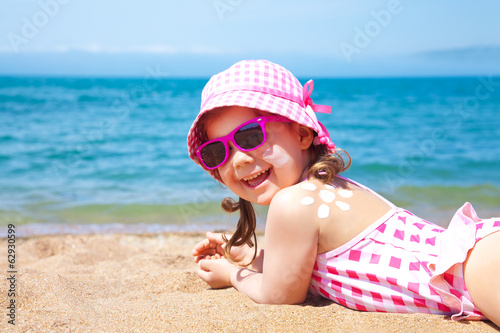 little girl at resort on sea