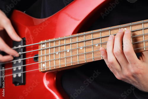Closeup of guitar and playing fingers