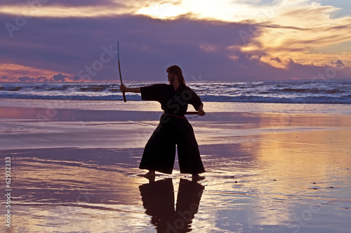 Young samurai women at sunset on the