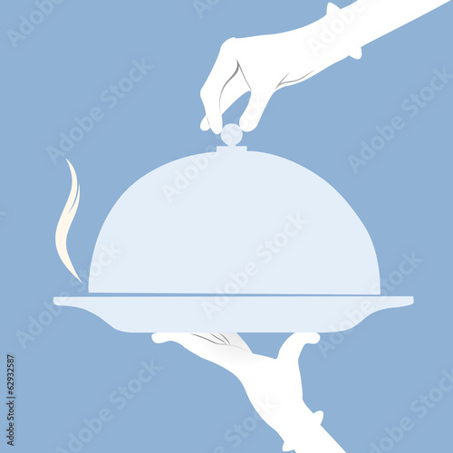 Waiter holding empty tray over a blue background