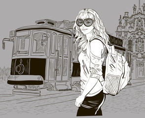 urban scene: fashion girl and old tram