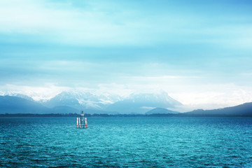 Surreal view of Bodensee with the Alps in the background
