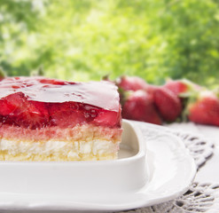 strawberry pie with cream and jelly in summer garden