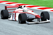 Race Car on Track - 62936950