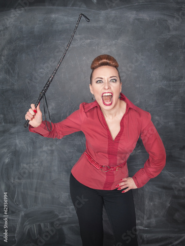 Angry screaming teacher with whip