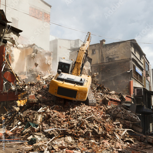 demolition excavator in the e city