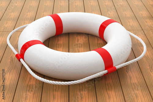 Lifebuoy on wood floor.