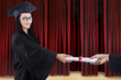 Attractive graduate given certificate on stage