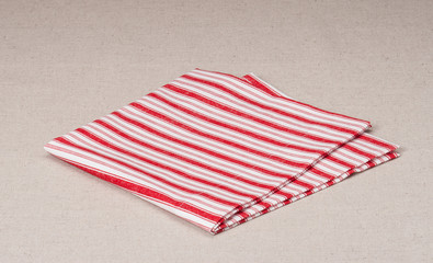 Red White Folded Napkin On Natural Linen Background