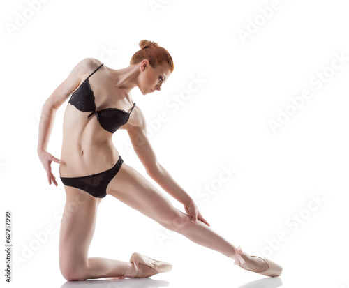 Graceful ballerina isolated on white backdrop